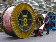 material-handling-pushing-cable-drums-paper-rolls-03