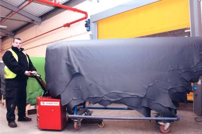 Motorized Tug for Moving Loads on Swivel Casters | PowerTug
